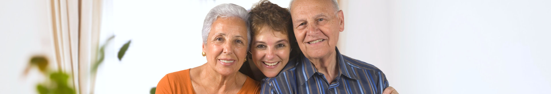 two elder and one young woman smilling
