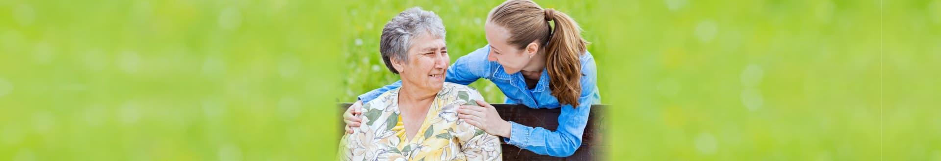 caregiver giving a smile to an elder
