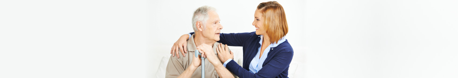 caregiver smilling to an elder