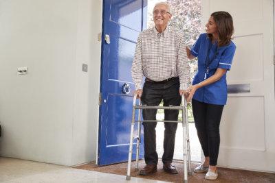 nurse caring senior man after surgery