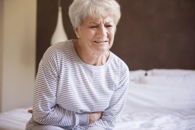 elder woman in pain